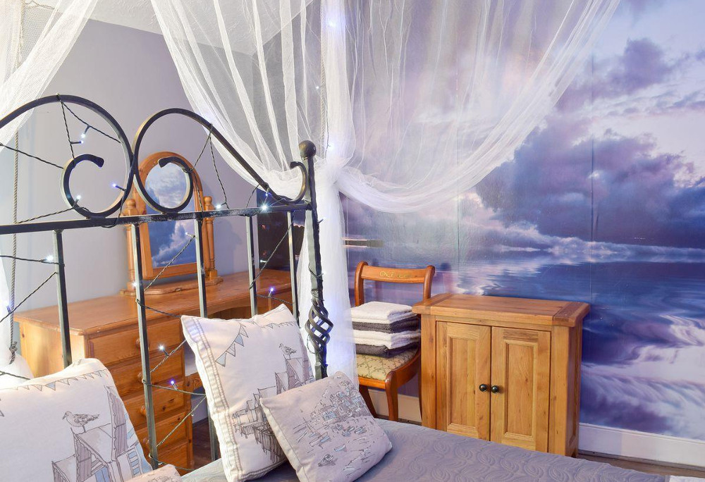 One of the beach themed bedrooms at Driftwood Cottage
